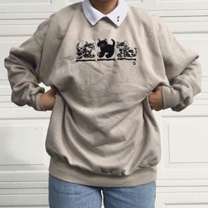 Adorable beige cat sweater with a printed collar